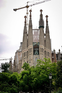 La Sagrada Familia in Barcelona, Spain during a dark and grey afternoon thunderstorm.