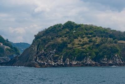 The rock cliffs near the ocean in San Sebastian, Spain
