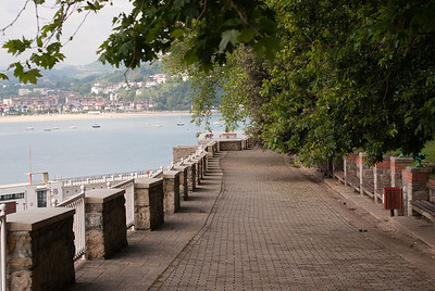 Paved pathwalk with a view of the ocean in San Sebastian, Spain
