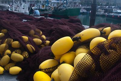 Close-up shot of fish net buoys in Old San Sebastian Port in Spain