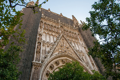 Looking up the facade of Seville Cathedral in Seville, Spain
