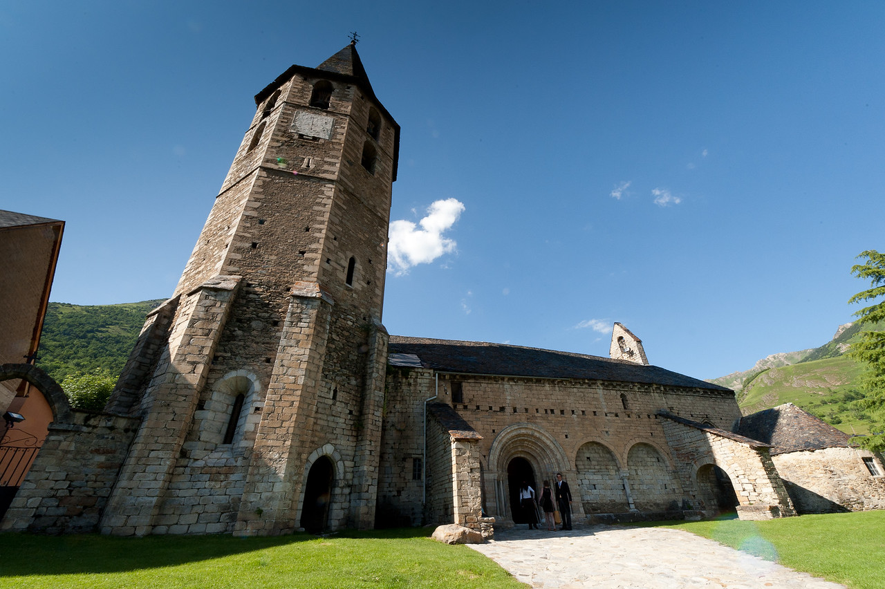 The bell tower and entrance door to Iglesia de San Miguel in Val d' Aran, Spain