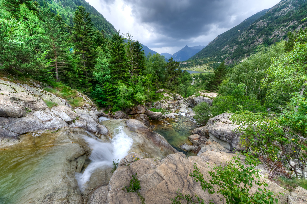 View of waterfall and valley in Vall de Boi, Spain