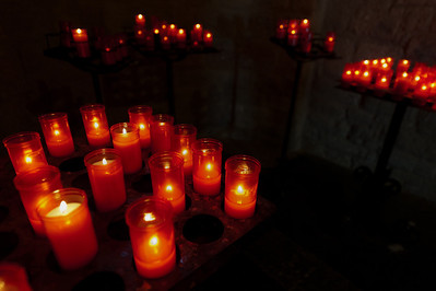 Lighted candles in Sant Climent in Taull, Vall de Boi, Spain