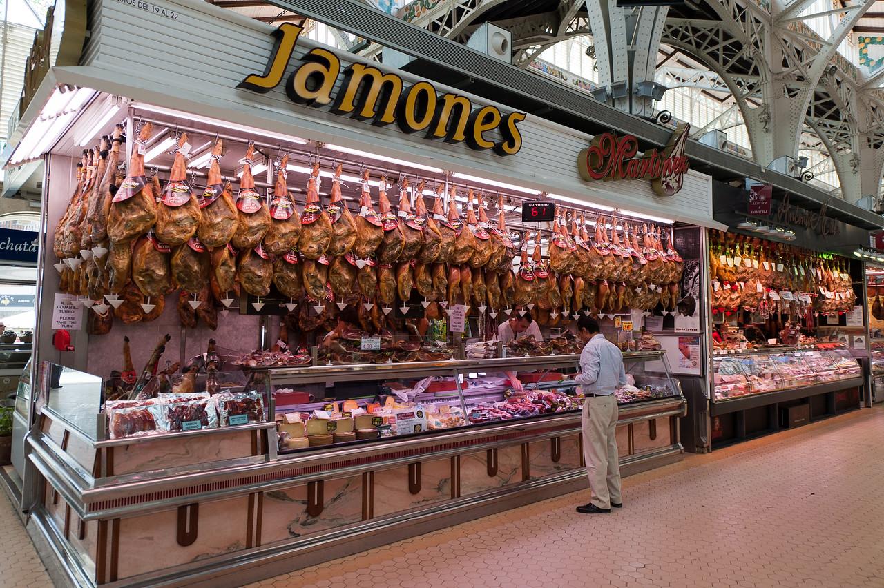 Meat vendor stall in Mercado Central, Valencia, Spain