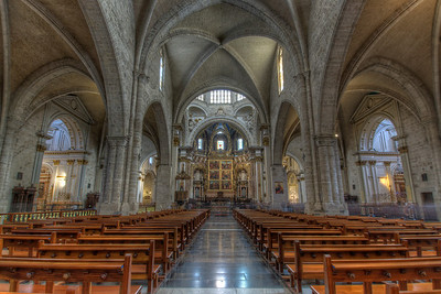 The aisle inside Valencia Cathedral in Spain