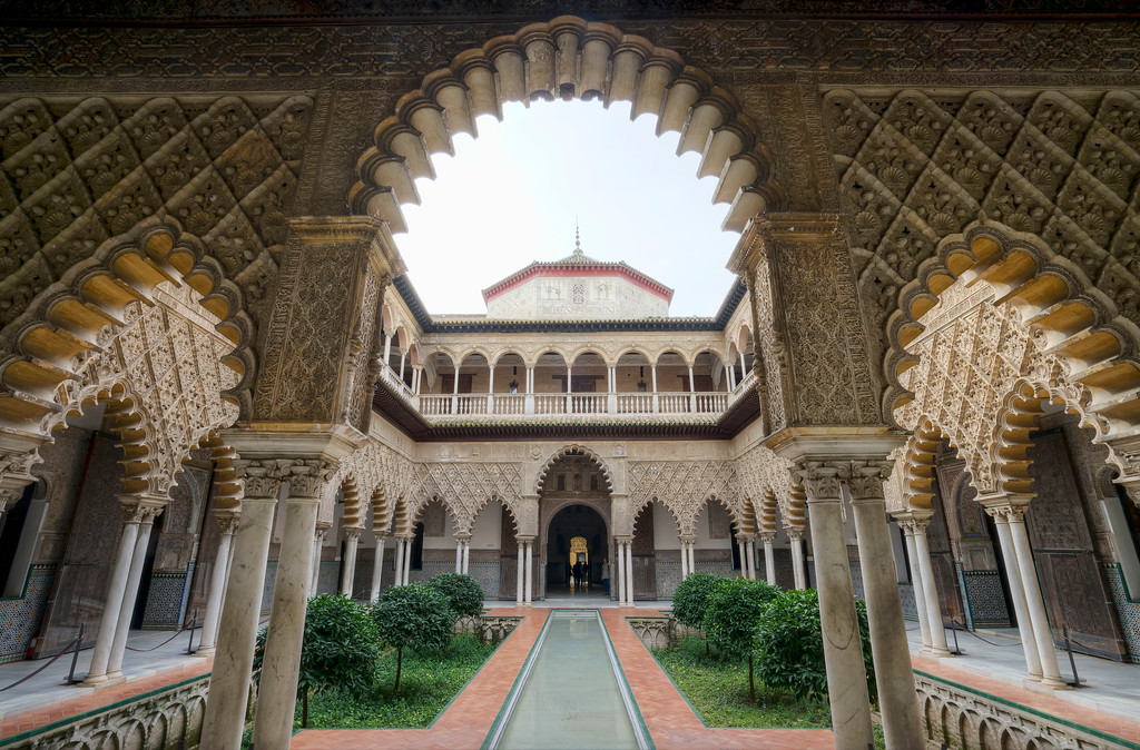 alcazar courtyard showing reflecting pool and detail of arches