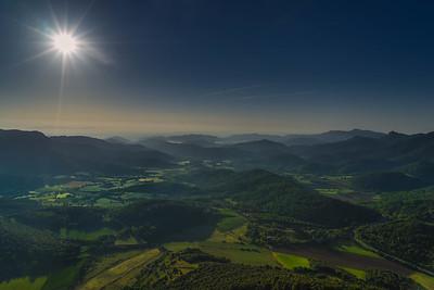 Hot Air Balloon over La Garrotxa, Spain with a Sun Star.
