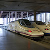 A RENFE class 102 AVE set sits along side a class 100 AVE set at Madrid Atocha, Spain, on the 10th March 2008