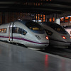 A pair of RENFE class 103 AVE sets sit at Madrid Atocha, Spain