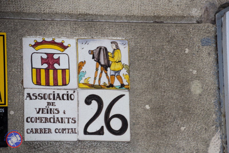 Tiles Representing One of the Trades Typical of this Street in Barcelona (©simon@myeclecticimages.com)