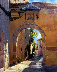 A narrow street in the old city of Segovia Spain