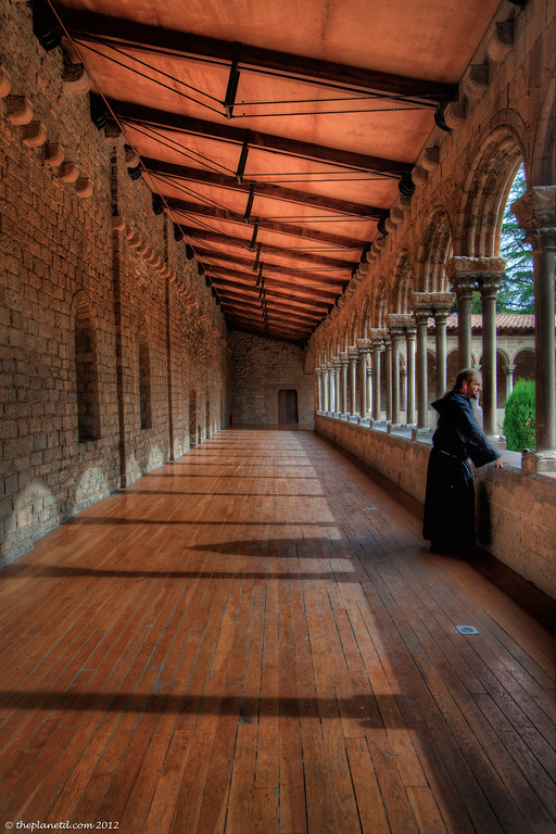 Monk Gazing at Monastery in Spain