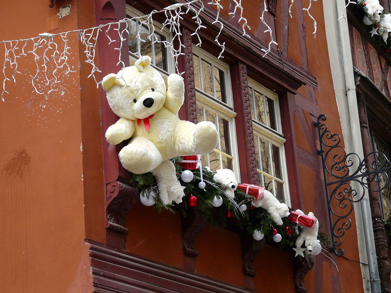 Teddy bears hang from rooftops in Strasbourg, France, at Christmas. We saw this cute bear on a Rhine River Christmas Markets cruise with AmaWaterways. December is a fun time to travel in Europe.