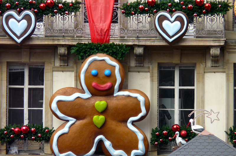 Gingerbread decorating hanging from a building
