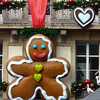 Mr. Gingerbread man hangs from a building in Strasbourg, France.