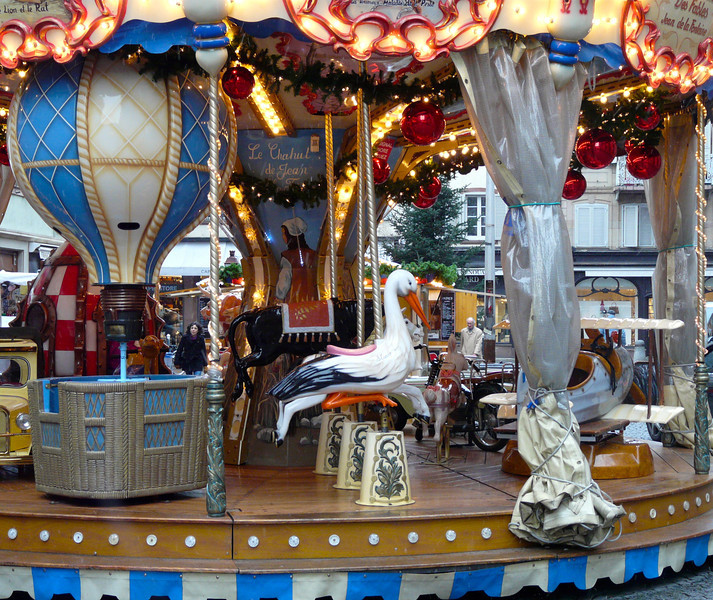 Carousel in Strasbourg, France, during Christmas. We enjoyed our time here as part of a Rhine River Christmas Markets cruise with AmaWaterways. It's a travel experience that we'd like to repeat.