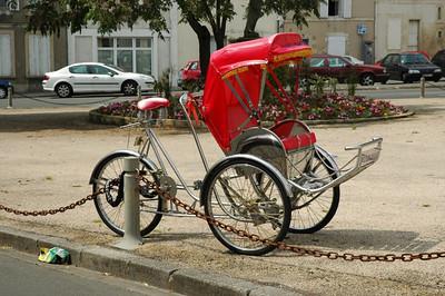 A bicycle rickshaw