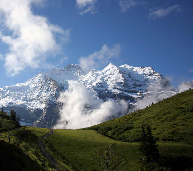 Jungfrau (or Virgin if translated) is mass imposing over the valley of beautiful green. We could hear snow crashing down the peak the entire time we were in the upper valley and while we were on our trip several Swiss Army recruits lost their lives on its massive wall.
