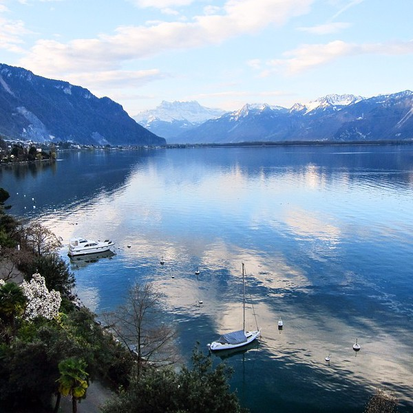 Early morning reflections over Lac Léman (Lake Geneva), view from our balcony. This is Montreux, Switzerland. via Instagram http://ift.tt/1aDbV0a