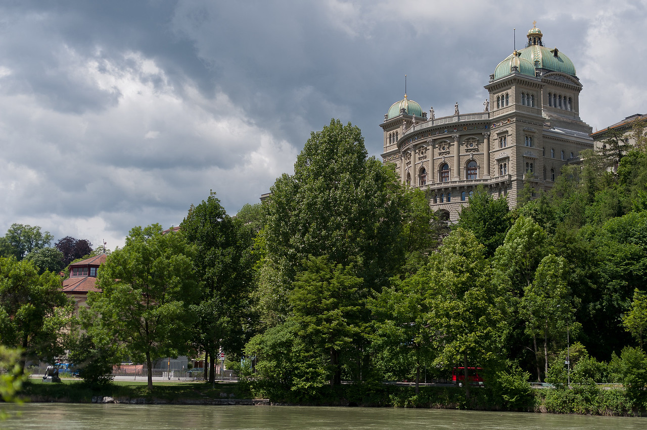 The Federal Palace of Switzerland behind thick canopy - Bern, Switzerland