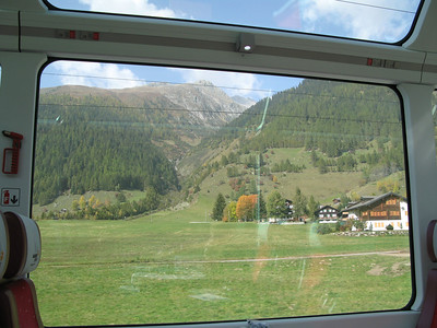 Nice Switzerland scenery framed by the window of the train car
