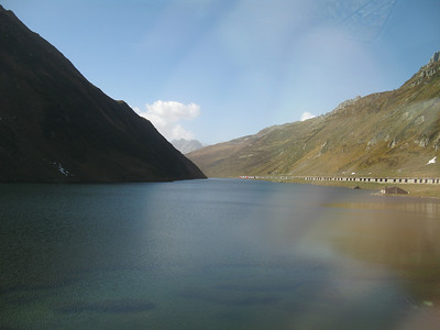 Other Glacier express train disappearing below the level of the lake as it makes its way down.