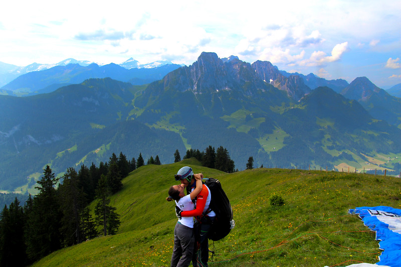 "Switzerland, Pays-d""Enhaut, Couple Kiss, Paragliding"