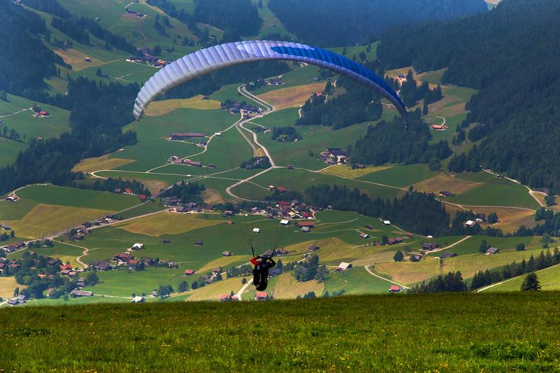 Switzerland, Pays-d'Enhaut, Paraglider Taking Off