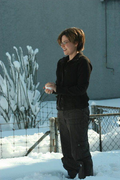 Terri forming a snowball to pitch to Coco, in our yard in Thalwil after a freak storm