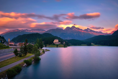 Sunset above lake St. Moritzersee with Swiss Alps and a mountain hotel