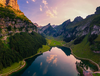 Aerial view of the Seealpsee lake in the Swiss Alps at sunset
