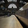 A Paris Sud-Est (PSE) set stands beneath the roof at Paris Gare du Nord.