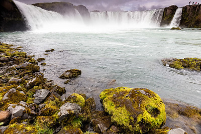 This is godafoss one of the largest and most popular waterfalls in northern Iceland.  Summer, winter, spring, and fall a great country to visit, but the main tourist sites are becoming very crowded.  The highlands however require a high clearance vehicle and four wheel drive.  Not crowed yet