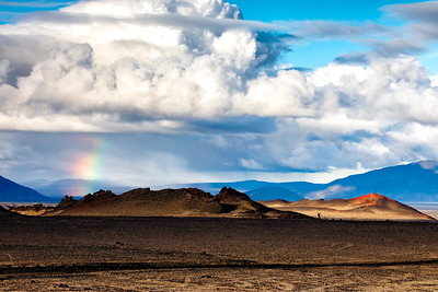 The different colored minerals producing red, brown and black mountains amidst the lava flow produce a variety of colors challenging the rainbow