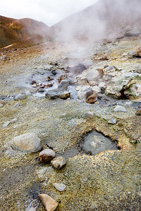 You can put your camera as close as you like if you can stand the smell of sulfur and the risk of being burned by a spurt of hot water