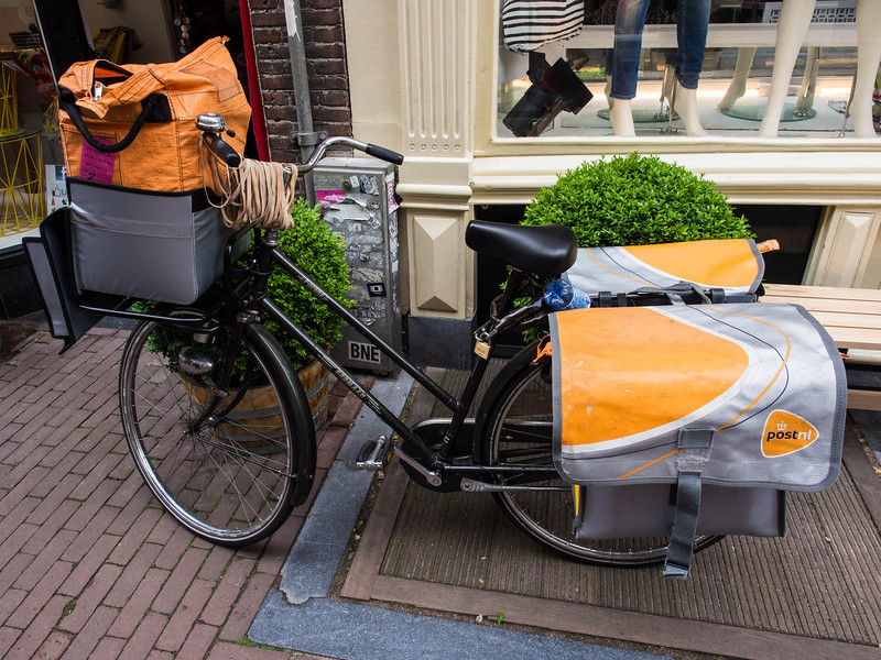 The  mail is delivered by bike