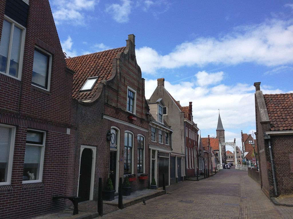 The narrow streets of Edam.  They do tilt the facades foreward, it's not entirely the camera angle.