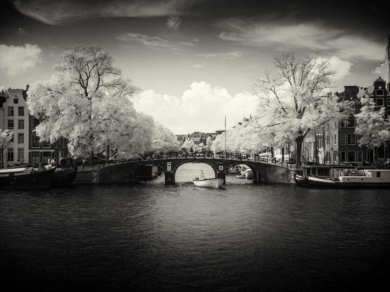 Something about this shot of the boat and the bridge across the Amstel just made me want to process it as a Black and White.