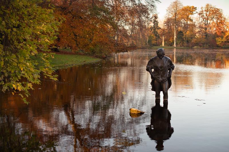 Woman in the pond in Wassenaar De Paauw park