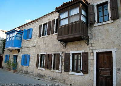 Stone houses on a street in Alaçatı.  (The house with the blue trim is a hotel - Sakızlı Han.)