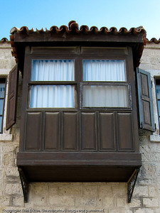 "Enclosed balconies like this one are known as ""cumba"" (bay window) in Turkish.  There's usually a window seat inside these bay windows, making them an ideal place to do some people watching."