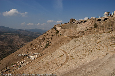 The Theater at the Acropolis of Pergamum.  The ruins at the top are of the Temple of Trajan; the ones to the right of the cavea are of the Temple of Dionysus.