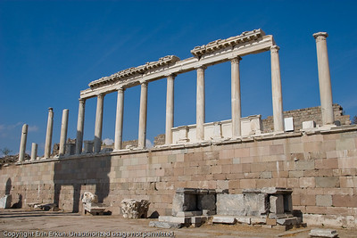 "The reconstructed north portico of the Temple of Trajan at the Acropolis of Pergamum.  The capitals on the columns are a rare style known as ""Pergamene.""  On the ground below is a rebuilt portion of the altar."