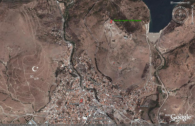 "This zoomed in image from Google Earth, shows the location of the Acropolis of Bergama in relation to the town.  Note the image of the Turkish flag created on a hillside nearby.  Beneath the crescent and star are the words ""Önce Vatan"" (Homeland First)."