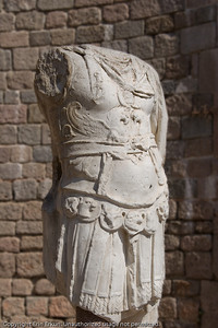 This torso is a replica from a statue found during the excavations of the Temple of Trajan.  There seems to be some debate as to whether the statue was of Trajan or Hadrian.