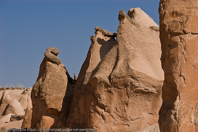 """I'm told that there is a rock """"Snake"""" on top of the chimney on the left. I see a squiggly basalt cap, but it doesn't look like a snake to me.  In the """"v"""" between the first two chimneys, however, is a figure that looks like the """"Madonna."""""""