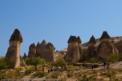 The people - and of course, the camel - provide perspective for the size of the fairy chimneys at Paşabağı. (Paşabağı = Pasha's Vineyard [paşa actually means, general, but the word is often used as a nickname])