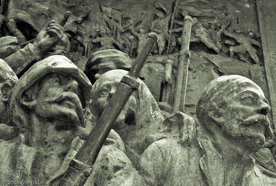 Kordon - A close look at one of the bronze reliefs decorating the base of the Atatürk Monument.