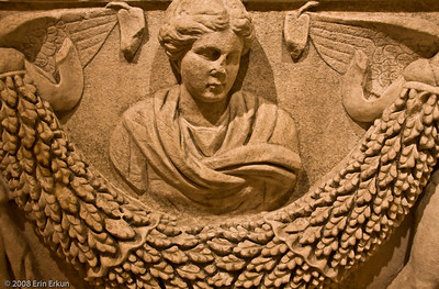 Garland Detail from a Sarcaphogus - Roman Period (Smyrna [İzmir]) History & Art Museum - Kültür Park   The relief carving in the center of the garland is likely a representation of the deceased.